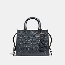 Image of Coach Australia BP/MIDNIGHT NAVY ROGUE 25 IN SIGNATURE LEATHER WITH FLORAL BOW PRINT