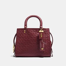 Image of Coach Australia OL/BORDEAUX ROGUE 25 IN SIGNATURE LEATHER WITH FLORAL BOW PRINT