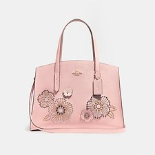 Picture of CHARLIE CARRYALL WITH TEA ROSE RIVETS