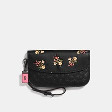 Picture of CLUTCH IN SIGNATURE LEATHER WITH FLORAL BOW PRINT