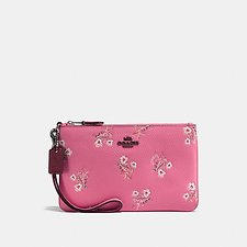 Picture of SMALL WRISTLET WITH FLORAL BOW PRINT