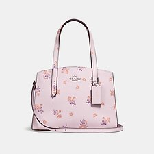 Image of Coach Australia SV/ICE PINK CHARLIE CARRYALL 28 WITH FLORAL BOW PRINT