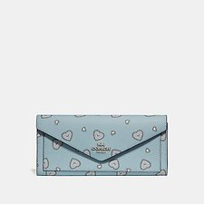 Image of Coach Australia SV/LIGHT TURQ WESTERN HEART SOFT WALLET WITH WESTERN HEART PRINT