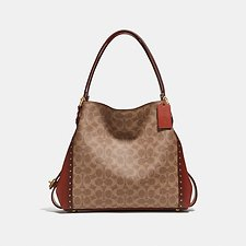 Image of Coach Australia B4/RUST EDIE SHOULDER BAG 31 IN SIGNATURE CANVAS WITH BORDER RIVETS