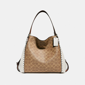 Image of Coach Australia  EDIE SHOULDER BAG 31 IN SIGNATURE CANVAS WITH BORDER RIVETS