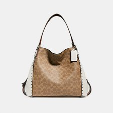 Image of Coach Australia BP/CHALK EDIE SHOULDER BAG 31 IN SIGNATURE CANVAS WITH BORDER RIVETS