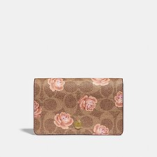 Image of Coach Australia B4/TAN FOLDOVER CARD CASE IN SIGNATURE ROSE PRINT