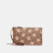 Picture of SMALL WRISTLET IN SIGNATURE ROSE PRINT
