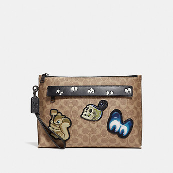 Image of Coach Australia  DISNEY X COACH CARRYALL POUCH WITH SIGNATURE PATCHWORK