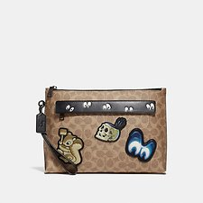 Image of Coach Australia KHAKI DISNEY X COACH CARRYALL POUCH WITH SIGNATURE PATCHWORK