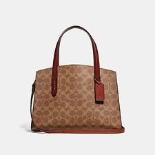 Image of Coach Australia B4/RUST CHARLIE CARRYALL 28 IN SIGNATURE CANVAS