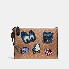 Picture of DISNEY X COACH TURNLOCK WRISTLET 30 IN SIGNATURE PATCHWORK