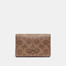 Image of Coach Australia B4/TAN RUST BUSINESS CARD CASE IN SIGNATURE CANVAS