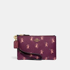 Image of Coach Australia GD/DARK BERRY SMALL WRISTLET WITH PARTY MOUSE PRINT