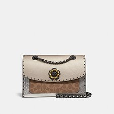 Image of Coach Australia  PARKER IN SIGNATURE CANVAS WITH RIVETS AND SNAKESKIN DETAIL