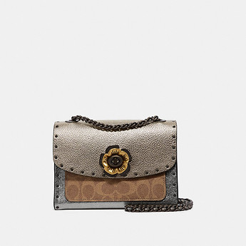 Image of Coach Australia  PARKER 18 IN SIGNATURE CANVAS WITH RIVETS AND SNAKESKIN DETAIL