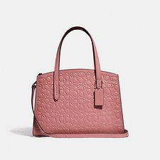 Image of Coach Australia SV/LIGHT BLUSH CHARLIE CARRYALL 28 IN SIGNATURE LEATHER