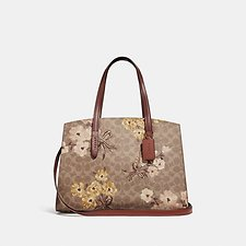 Image of Coach Australia B4/TAN RUST BOW CHARLIE CARRYALL IN SIGNATURE CANVAS WITH PRAIRIE  FLORAL PRINT