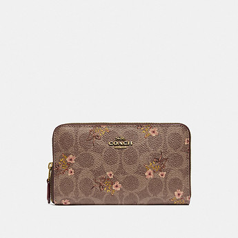 Image of Coach Australia  MEDIUM ZIP AROUND WALLET IN SIGNATURE CANVAS WITH FLORAL PRINT