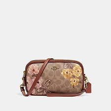 Image of Coach Australia B4/TAN SADIE CROSSBODY CLUTCH IN SIGNATURE CANVAS WITH PRAIRIE FLORAL PRINT