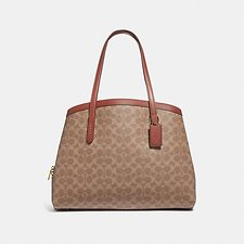 Image of Coach Australia B4/TAN RUST CHARLIE CARRYALL 40 IN SIGNATURE CANVAS