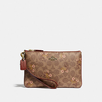 Image of Coach Australia  SMALL WRISTLET IN SIGNATURE CANVAS WITH FLORAL BOW PRINT