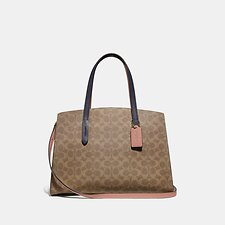 Image of Coach Australia B4/TAN INK LIGHT PEACH CHARLIE CARRYALL IN COLORBLOCK SIGNATURE CANVAS