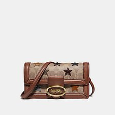 Image of Coach Australia B4/TAN 1941 SADDLE RILEY CONVERTIBLE BELT BAG IN SIGNATURE CANVAS WITH STAR APPLIQUE AND SNAKESKIN DETAIL