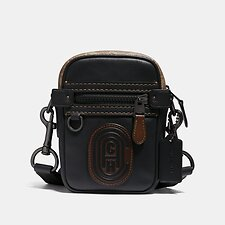 Image of Coach Australia  DYLAN 10 WITH SIGNATURE CANVAS BLOCKING AND COACH PATCH