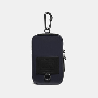 Image of Coach Australia  HYBRID POUCH 10 WITH SIGNATURE CANVAS BLOCKING