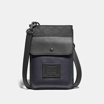 Image of Coach Australia  HYBRID POUCH WITH SIGNATURE CANVAS BLOCKING