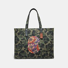 Image of Coach Australia JI/MILITARY WILD BEAST TOTE 42 WITH WILD BEAST PRINT AND KAFFE FASSETT COACH PATCH