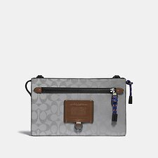 Image of Coach Australia SILVER/SADDLE/BLACK RIVINGTON CONVERTIBLE POUCH IN REFLECTIVE SIGNATURE CANVAS