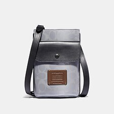 Image of Coach Australia SILVER/SADDLE/BLACK HYBRID POUCH IN REFLECTIVE SIGNATURE CANVAS